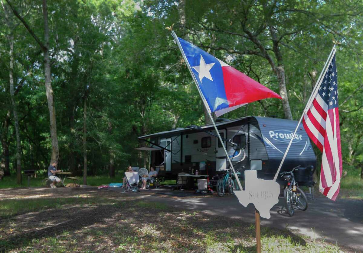 After two months in lockdown, Bart and Martha Squires of Sweeney take their daughter, Jordan, 15, on a camping trip in May 2020 at Brazos Bend State Park in Needville. Booking a campsite now takes reservations up to a year in advance.