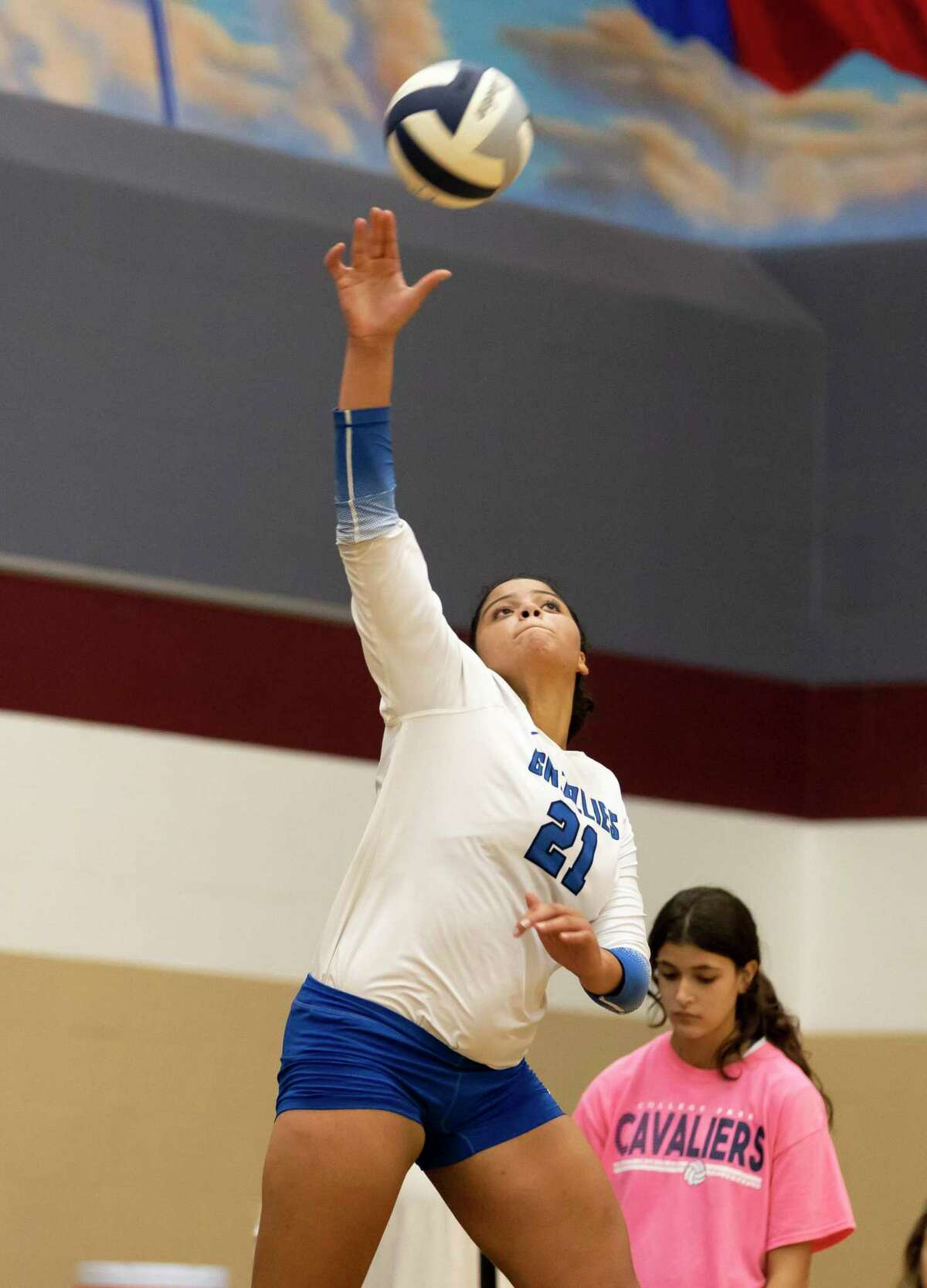 Grand Oaks outside hitter Fallon Thompson (21) serves the ball during the second set of a District 13-6A volleyball match against College Park at College Park High School, Tuesday, Sept. 21, 2021, in The Woodlands.