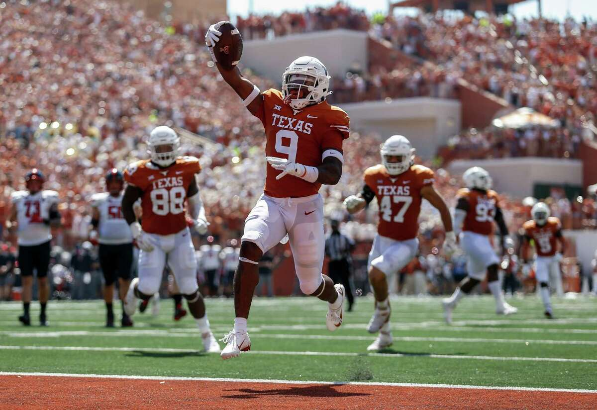 AUSTIN, TEXAS - SEPTEMBER 25: Josh Thompson #9 of the Texas Longhorns intercepts a pass and returns it for a touchdown in the second quarter against the Texas Tech Red Raiders at Darrell K Royal-Texas Memorial Stadium on September 25, 2021 in Austin, Texas.