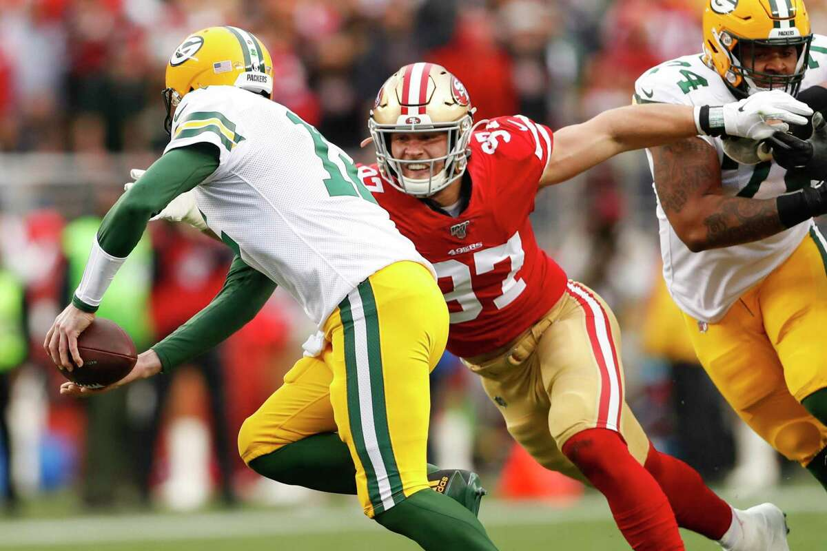 San Francisco 49ers?• Nick Bosa chases Green Bay Packers?• Aaron Rodgers in the first quarter during the NFC Championship game between the San Francisco 49ers and the Green Bay Packers at Levi?•s Stadium on Sunday, Jan. 19, 2020 in Santa Clara, Calif.