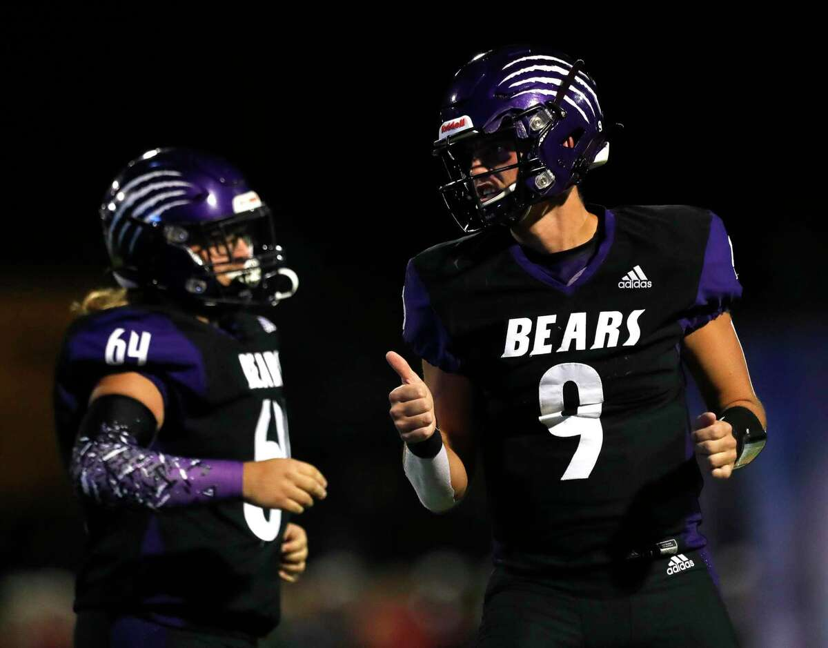 Montgomery quarterback Brock Bolfing (9) gives a thumbs-up after throwing a 49-yard touchdown pass to wide receiver Maddox Plazek during the second quarter of a non-district high school football game, Thursday, Sept. 23, 2021, in Montgomery.