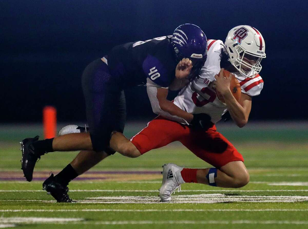 Oak Ridge quarterback Ethan Rodriguez (3) is brought down by Montgomery linebacker Leslie Williams (40) during the second quarter of a non-district high school football game, Thursday, Sept. 23, 2021, in Montgomery.