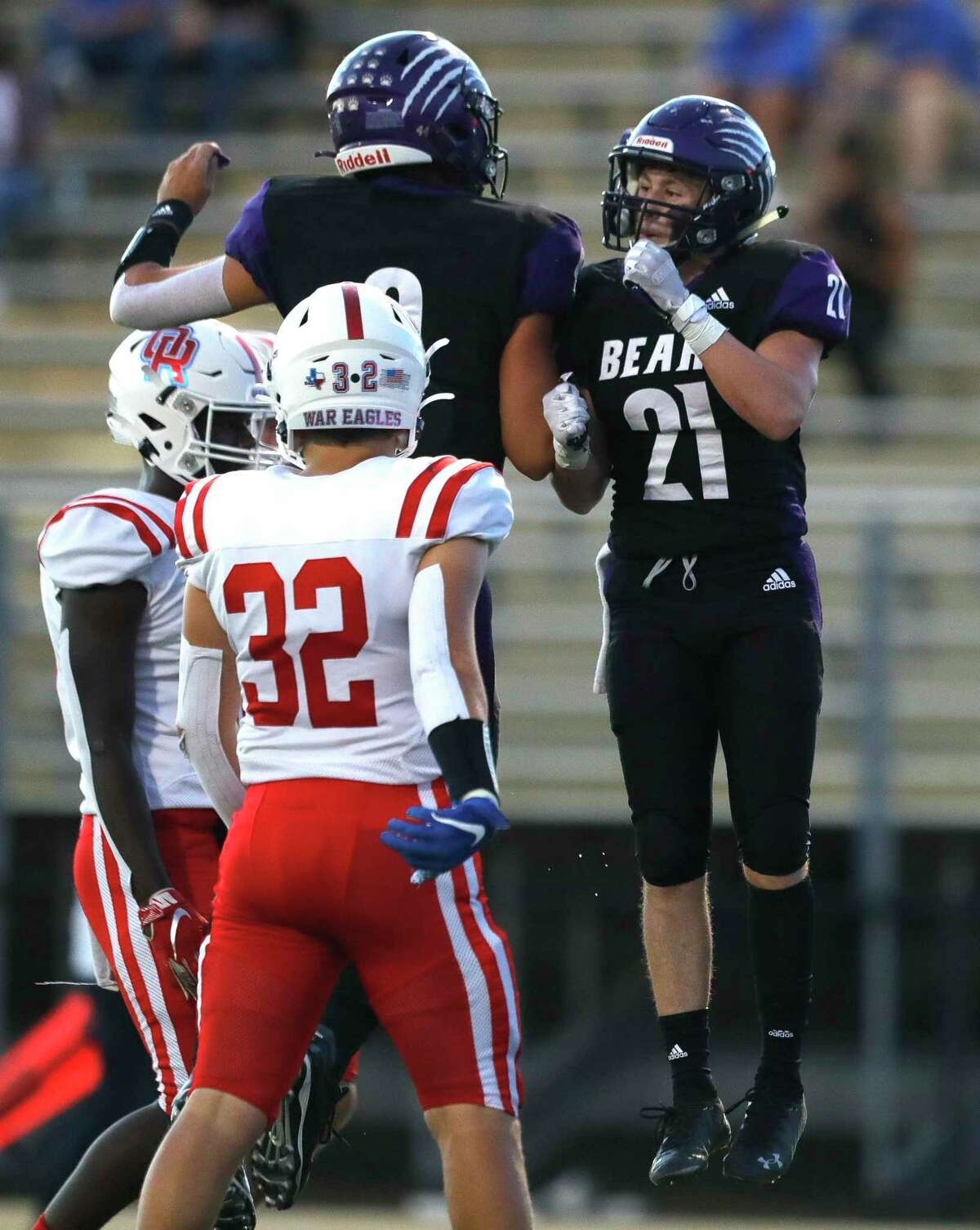 Montgomery wide receiver Justin Herman (21) celebrates with quarterback Brock Bolfing (9) after the two connected for a 24-yard touchdown pass during the first quarter of a non-district high school football game, Thursday, Sept. 23, 2021, in Montgomery.