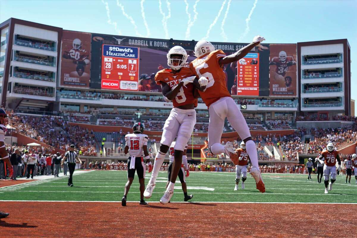 Texas wide receiver Xavier Worthy (8) celebrates his touchdown catch against Texas Tech with Joshua Moore (6) during the first half of an NCAA college football game on Saturday, Sept. 25, 2021, in Austin, Texas.