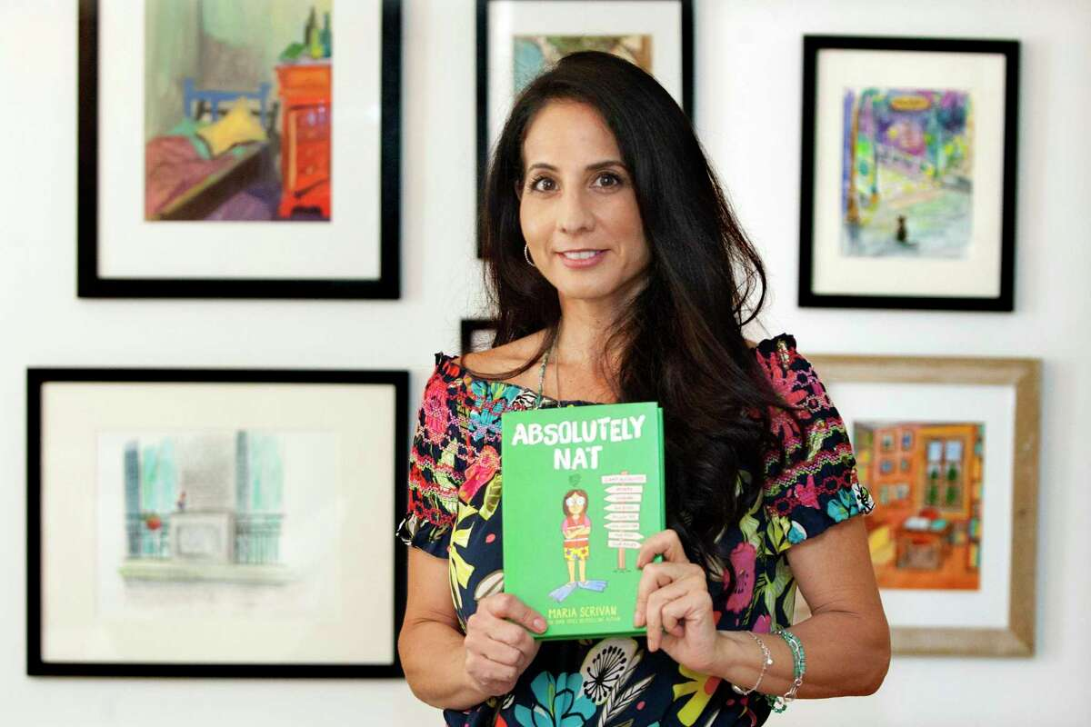 """Author Maria Scrivan poses ahead of the release of her third book: """"Absolutely Nat"""" at her home in Greenwich, Conn., on Friday September 17, 2021."""