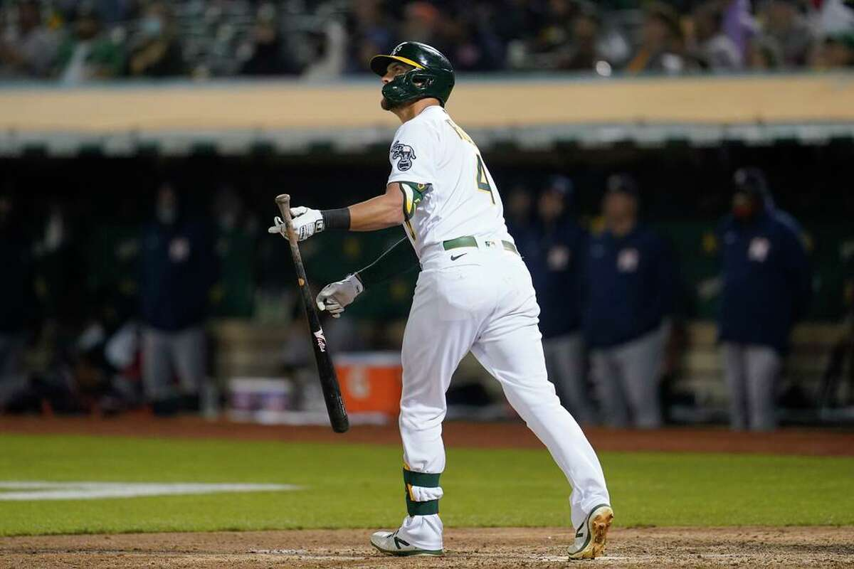 Oakland Athletics' Chad Pinder watches his grand slam home run against the Houston Astros during the seventh inning of a baseball game in Oakland, Calif., Friday, Sept. 24, 2021. (AP Photo/Jeff Chiu)