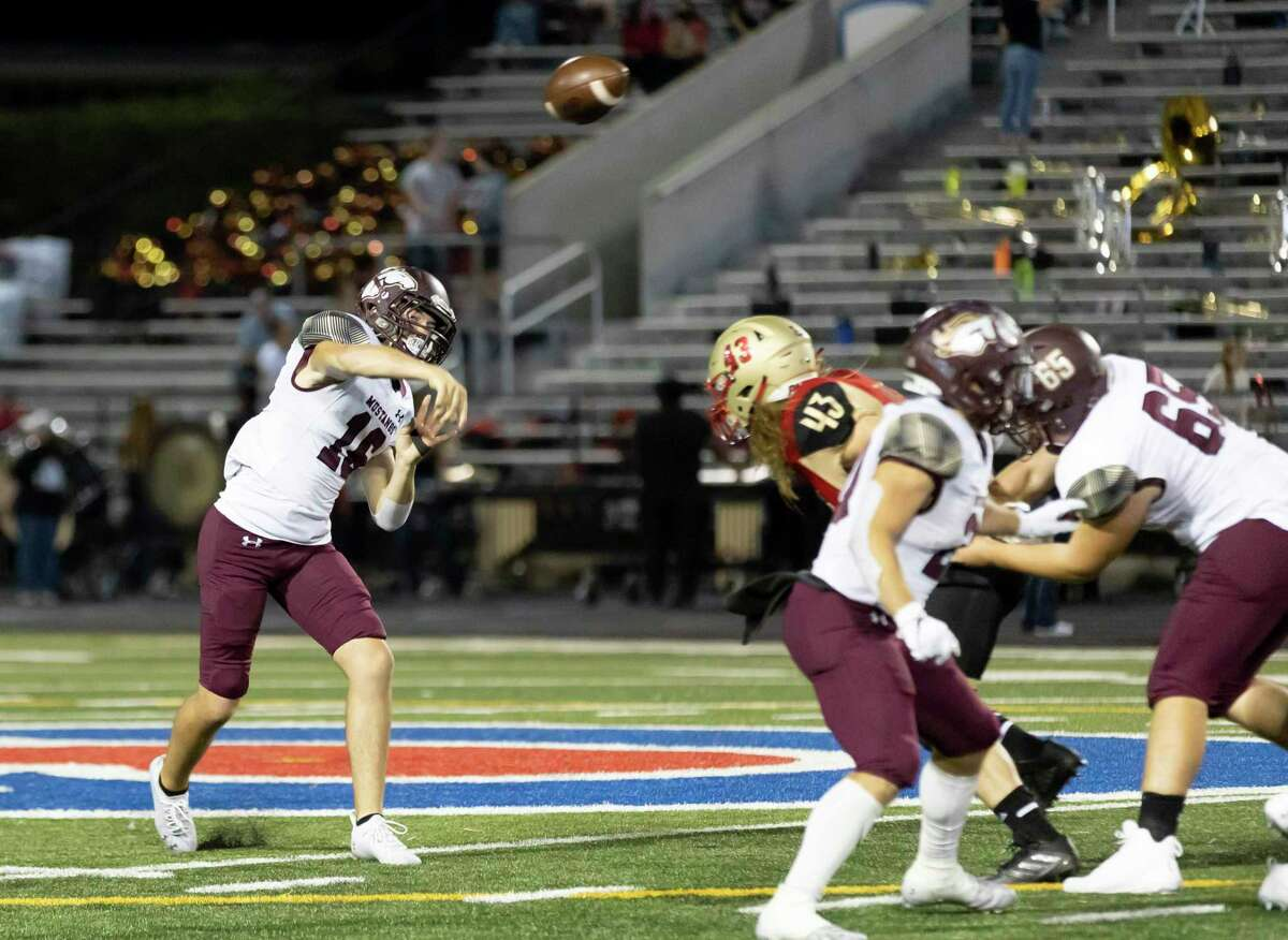 Magnolia West quarterback Ryan Ojeda (16) throws during the third quarter of a District 8-5A (Div. I) football game against Caney Creek at Buddy Moorhead Stadium, Friday, Sept. 24, 2021, in Conroe.