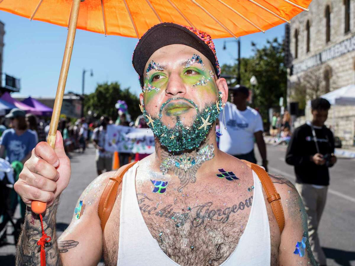 Prestan Gonzales, 35, parades through downtown during the annual Mermaid Promenade in San Marcos on Saturday.