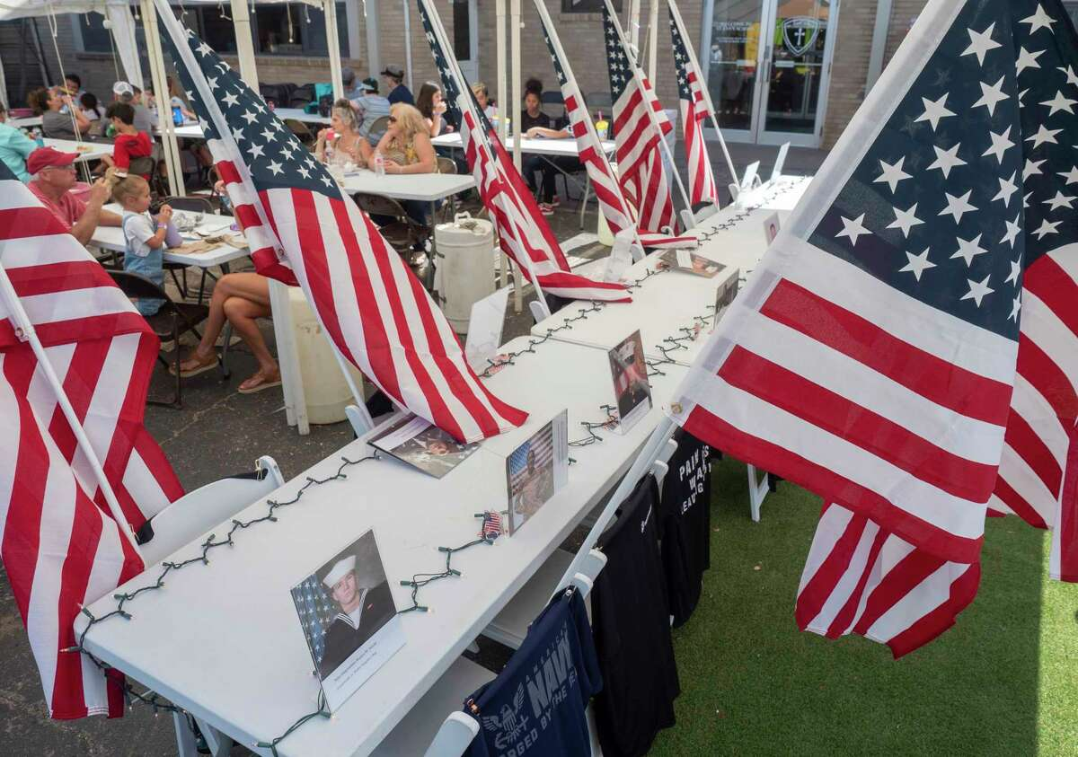 Seats were set up and reserved for the 13 service members who recently died as American troops left Afghanistan 09/25/2021 afternoon at St. Ann's School Fair. Tim Fischer/Reporter-Telegram