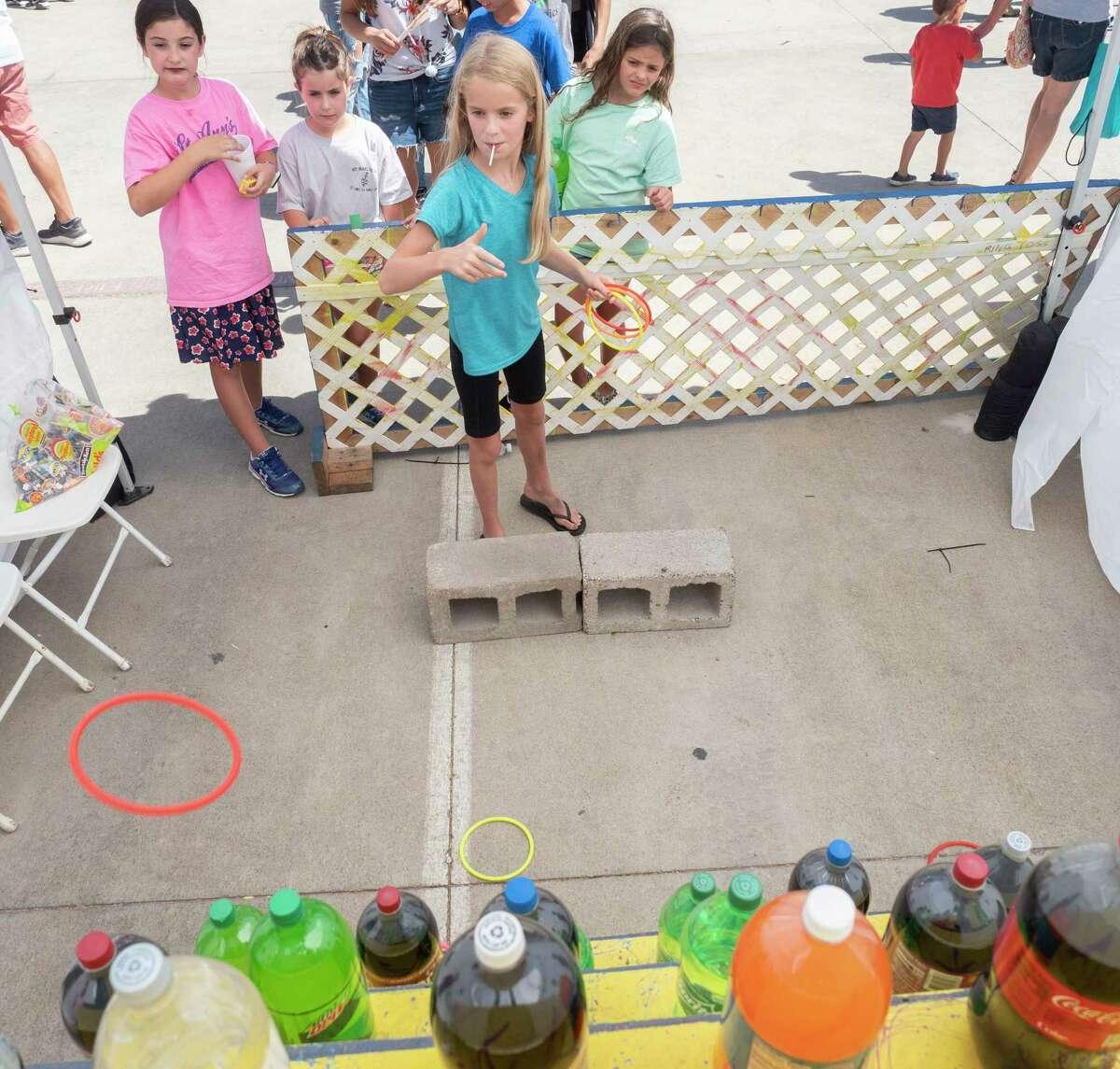 Fairgoers enjoy a pleasant 09/25/2021 afternoon at St. Ann's School Fair. Tim Fischer/Reporter-Telegram