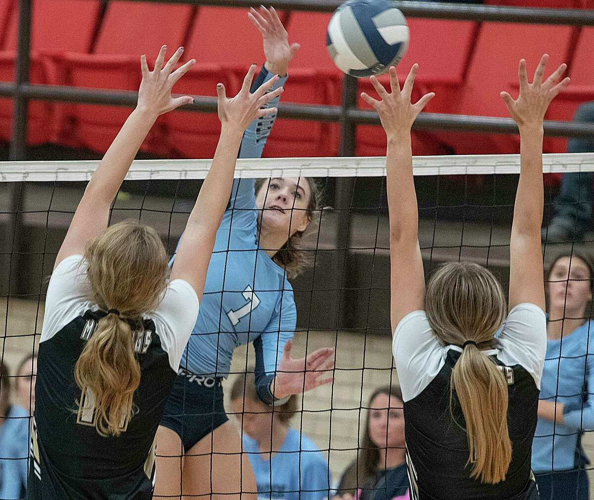 Greenwood's Kirklyn Smith tries to get the ball past Andrews' Tori Woodside and Jamie Blinco-Butler blocks 09/25/2021 at Greenwood High School gym. Tim Fischer/Reporter-Telegram