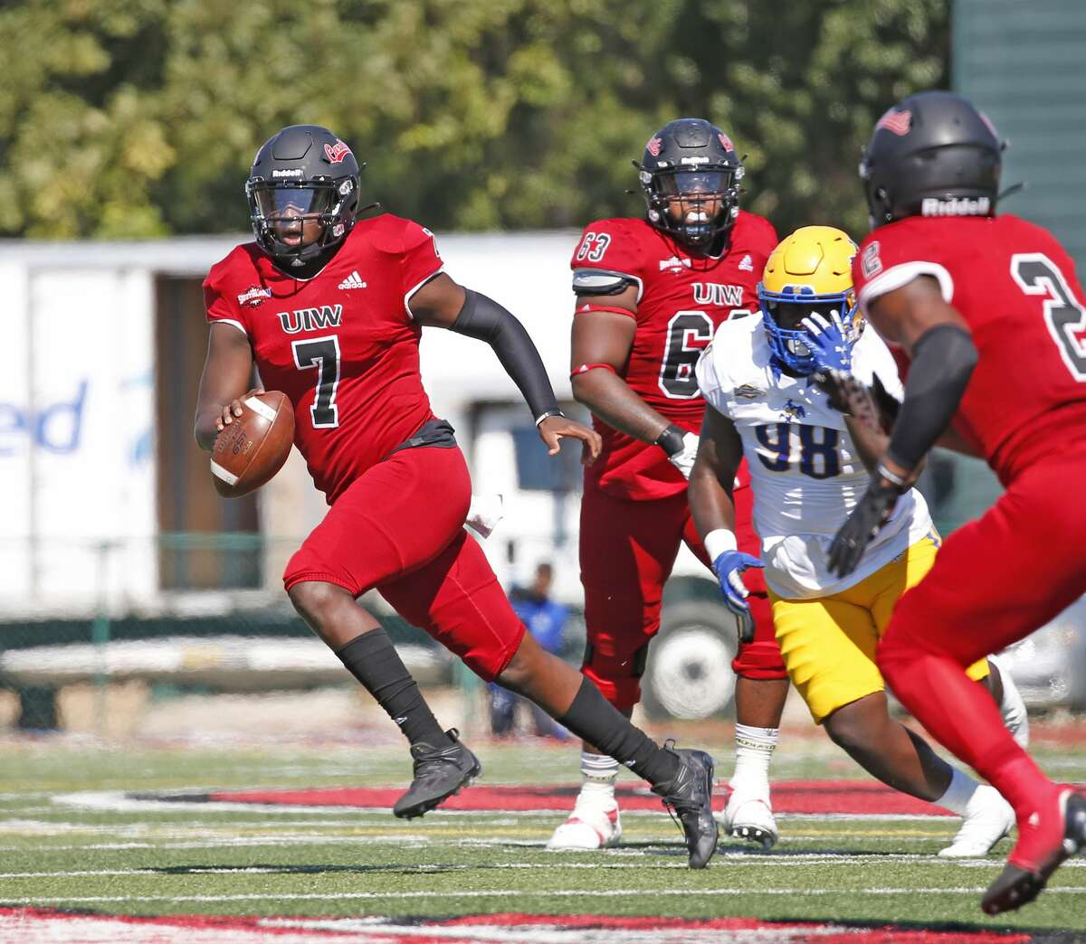 UIW quarterback Cameron Ward scrambles for yardage on Saturday, Sept. 25, 2021. Halftime score UIW 21 McNeese 0.