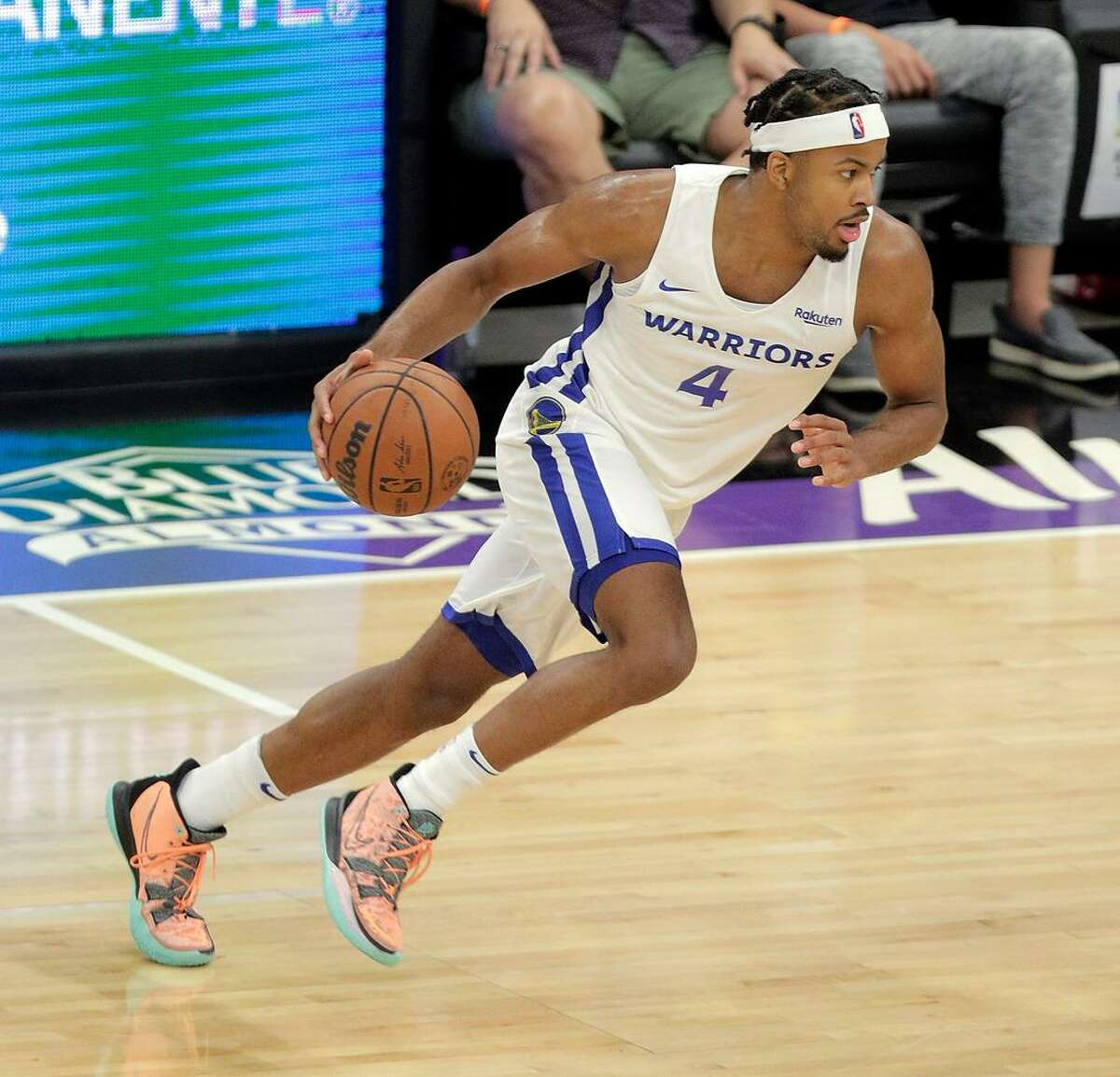 Moses Moody (4) dribbles to the basket in the first half as the Golden State Warriors summer league played the Miami Heat Summer league in the 2021 California Classic at Golden 1 Center in Sacramento, Calif., on Wednesday, August 4, 2021.