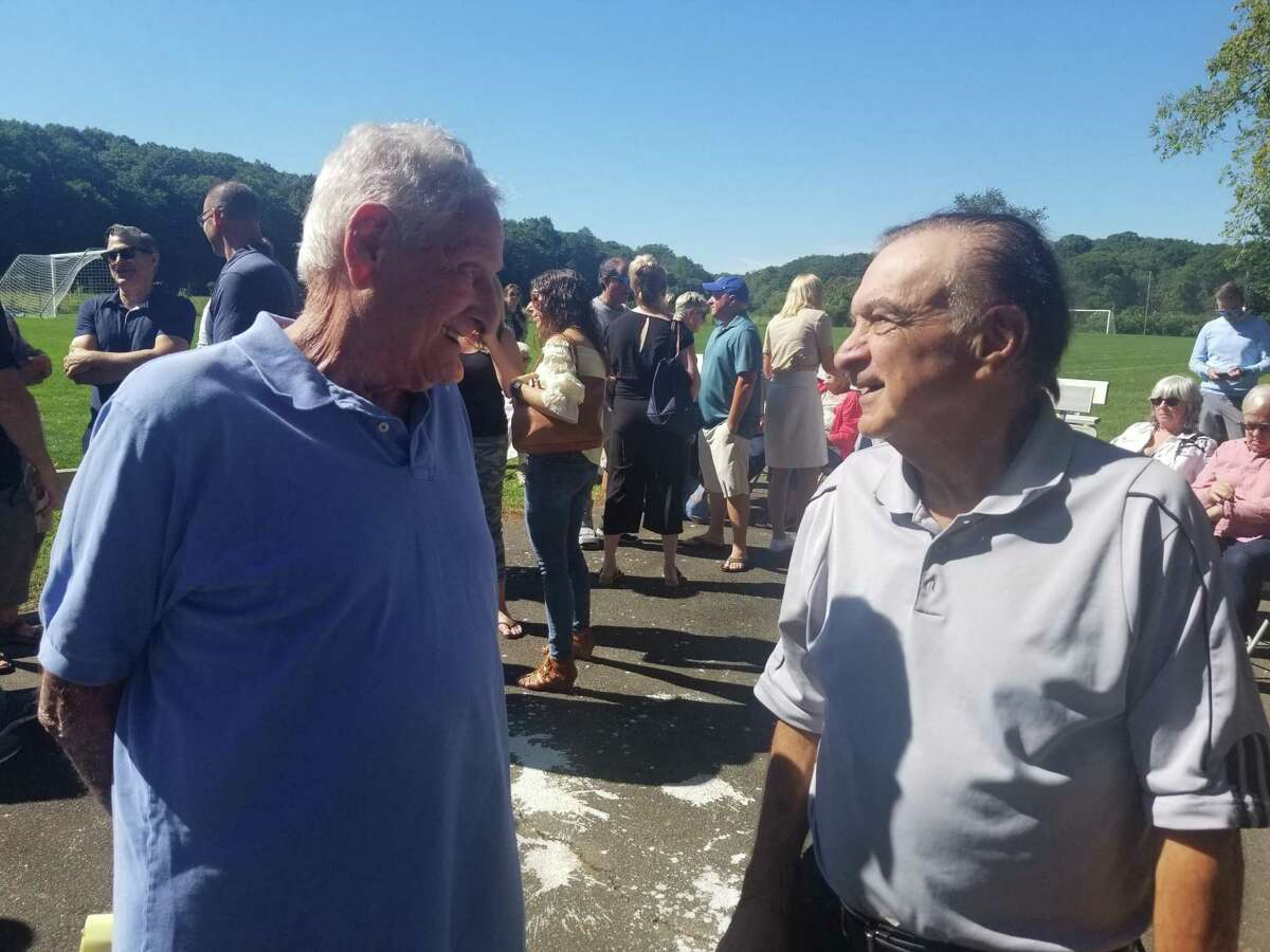 Bill Wallach, left, chats with Bib Dikranian, who was the Southern Connecticut State University men's soccer coach, at the renaming of the Bill Wallach Soccer Fields in Guilford on Sept. 25, 2021.