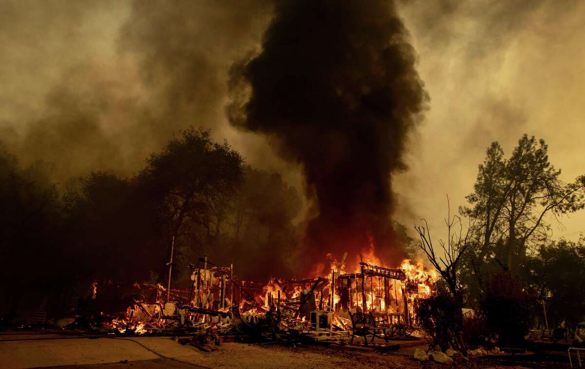 Flames consume a house near the Old Oregon Trail as the Fawn Fire burns north of Redding in Shasta County on Thursday. Crews made progress against the blaze Saturday, and some of the thousands of people who fled their homes in the path were allowed to return in specific areas. Some evacuation orders were downgraded to warnings.