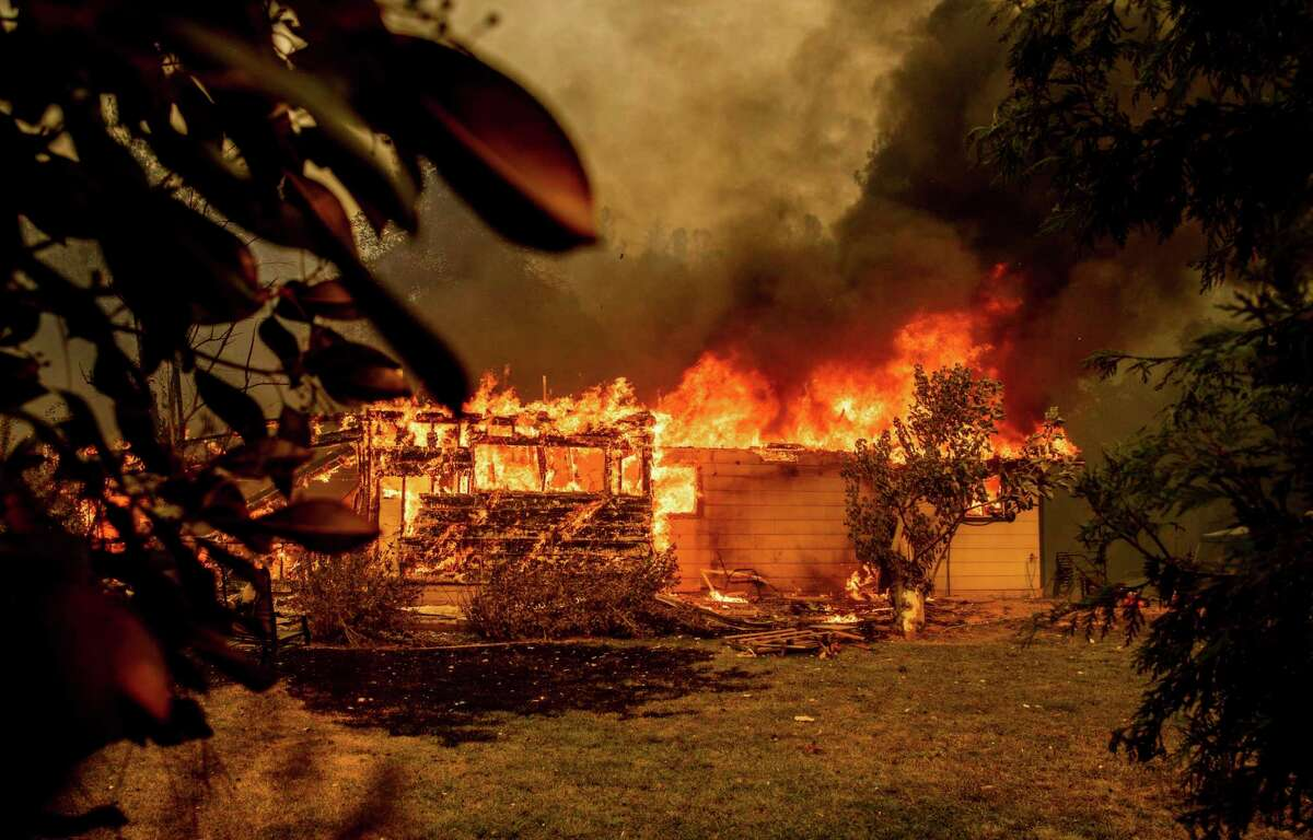 A house near Old Oregon Trail goes up in flames as the Fawn Fire burns north of Redding in Shasta County on Thursday. The blaze was still spreading on Saturday.