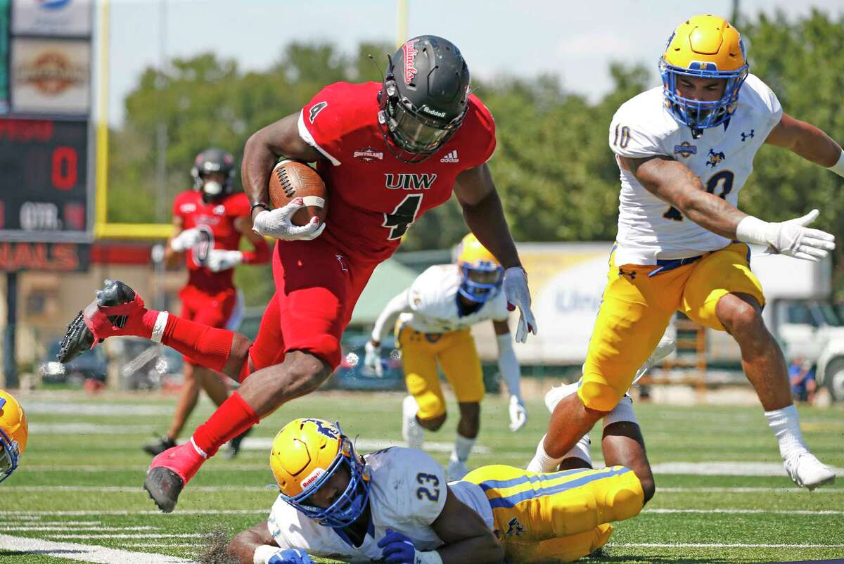 UIW running back Kevin Brown(4) avoid the tackle of McNeese linebacker Kordell Wiliams in the fourth quarter on Saturday, Sept. 25, 2021. Halftime score UIW 21 McNeese 0.
