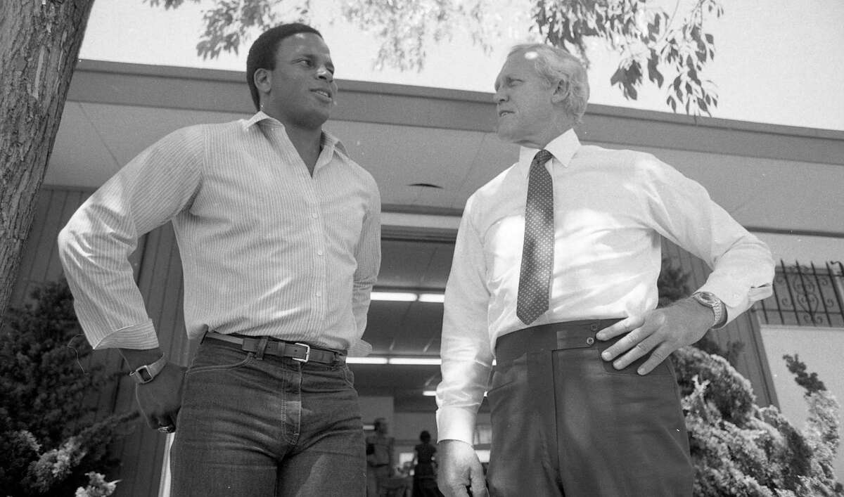 Rookie Ronnie Lott and 49ers head coach Bill Walsh talk at training facility in Redwood City, April 28, 1981
