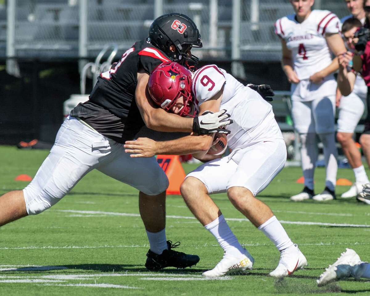 RPI defensive lineman Marc Anderson sacks St. John Fisher quarterback Joseph Torillo during a game at the East Campus Stadium on the RPI campus in Troy, NY, on Saturday, Sept. 25, 2021 (Jim Franco/Special to the Times Union)