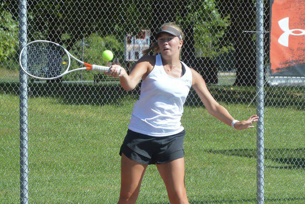 Edwardsville's Hannah Colbert makes a forehand return during her No. 2 singles on Saturday against Columbia Rock Bridge in the Southern Illinois Duals.