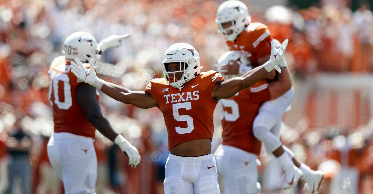 Bijan Robinson #5 of the Texas Longhorns reacts after a touchdown pass thrown by Casey Thompson #11 in the second quarter against the Texas Tech Red Raiders at Darrell K Royal-Texas Memorial Stadium on September 25, 2021 in Austin, Texas. (Photo by Tim Warner/Getty Images)