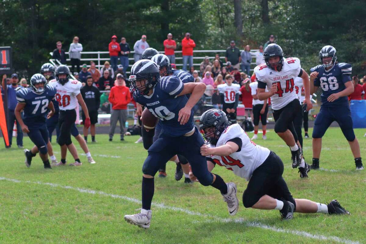 Lucas Stapley breaks a tackle on one of several big runs for Brethren on Sept. 25.