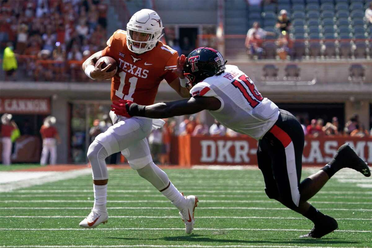 Texas quarterback Casey Thompson (11) threw for five touchdowns and added a rushing score against Texas Tech.