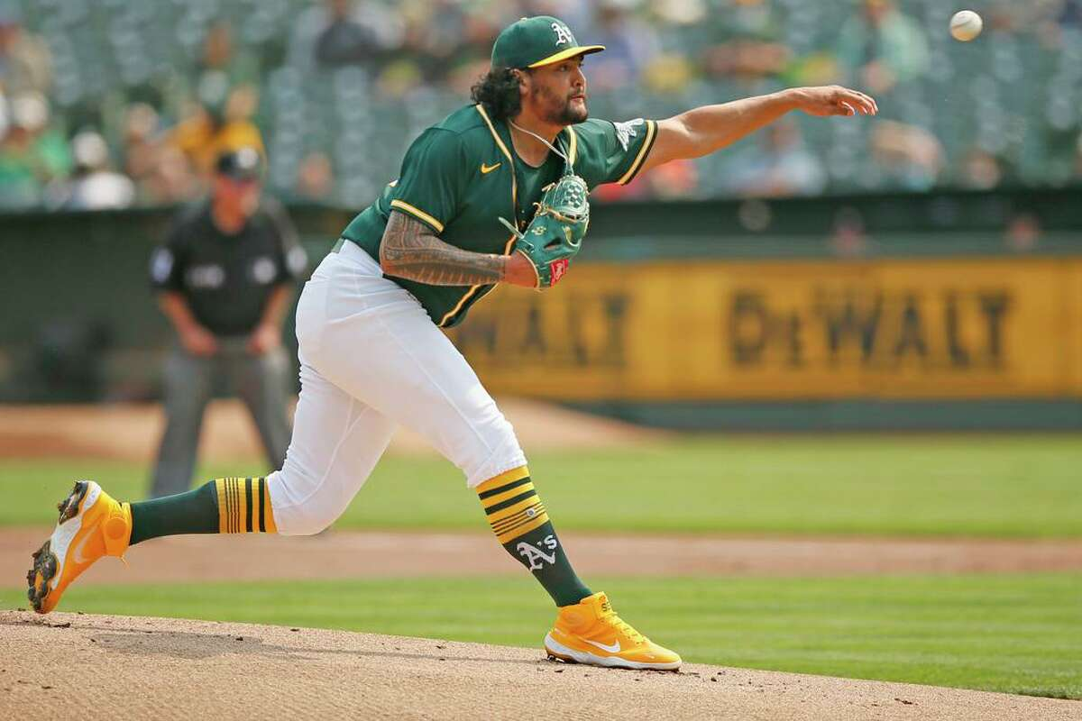 Oakland Athletics starting pitcher Sean Manaea (55) pitches against the Houston Astros in the first inning during an MLB game at RingCentral Coliseum on Saturday, Sept. 25, 2021, in Oakland, Calif.