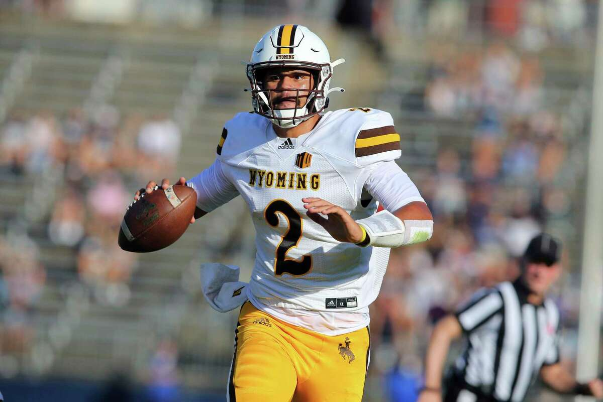 Wyoming quarterback Sean Chambers (2) throws the ball during the first half of an NCAA football game against Connecticut on Saturday, Sept. 25, 2021, in East Hartford, Conn. (AP Photo/Stew Milne)