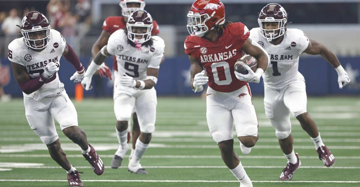 AJ Green #0 of the Arkansas Razorbacks runs past a host of Texas A&M Aggies defenders before scoring a touchdown in the first half of the Southwest Classic at AT&T Stadium on September 25, 2021 in Arlington, Texas. (Photo by Ron Jenkins/Getty Images)