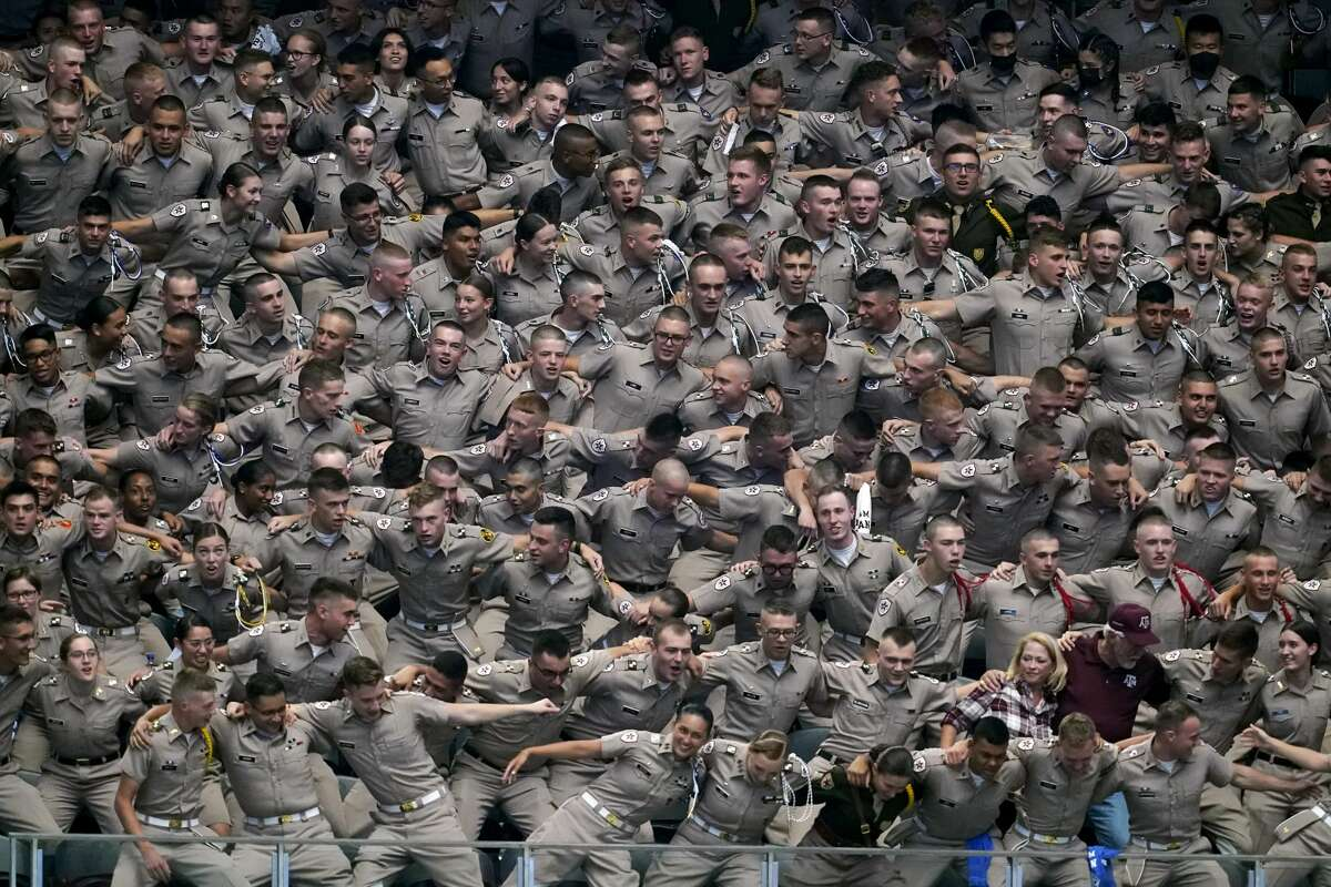 The Texas A&M Corps of Cadets and fans cheer on their team in the first half of an NCAA college football game against Arkansas in Arlington, Texas, Saturday, Sept. 25, 2021. (AP Photo/Tony Gutierrez)