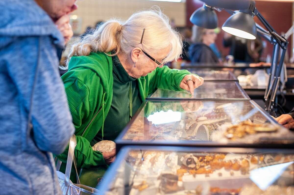 Midland resident Donna Baily looks at jewelry during at the Midland Antique Festival on Sept. 25, 2021 at the Midland County Fairgrounds. The festival returned after an 18-month hiatus. (Andrew Mullin/amullin@hearstnp.com)