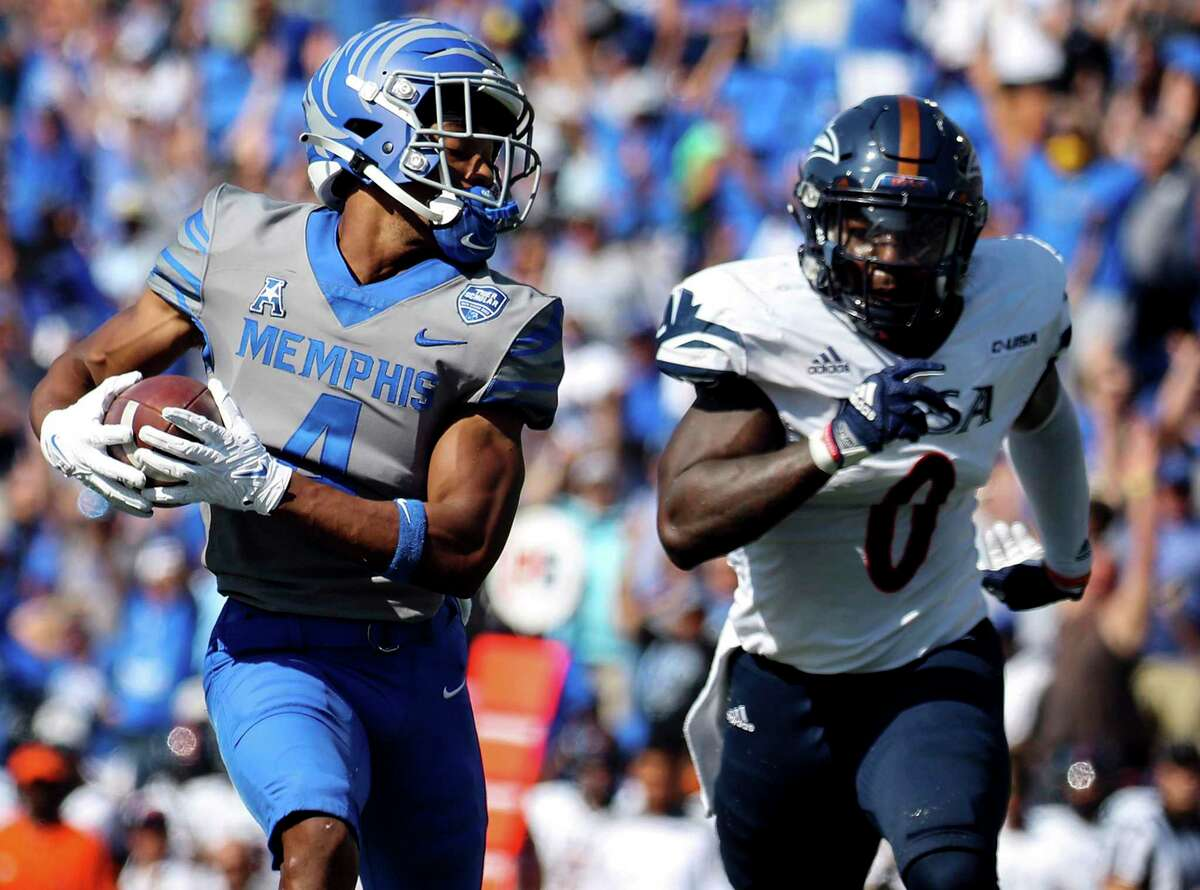 University of Memphis receiver Calvin Austin III (4) scrambles for a first down while being chased by University of Texas San Antonio safety Rashad Wisdom (0) during an NCAA college football game at the Liberty Bowl Memorial Stadium in Memphis, Saturday, Sept. 25, 2021. (Patrick Lantrip/Daily Memphian via AP)