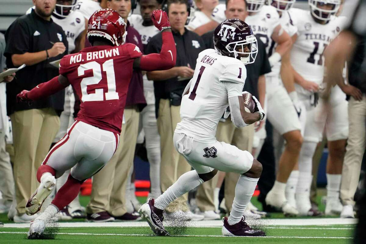 Texas A&M wide receiver Demond Demas (1) catches a pass in front of Arkansas defensive back Montaric Brown, who later intercepted a pass to set up a late Razorbacks field goal.