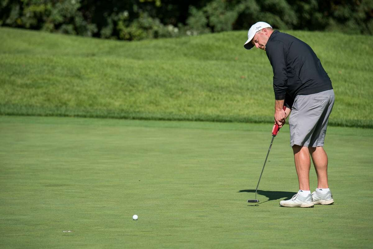 Jim Gifford of Mohawk Golf Club hits his put during Round 2 of the 2021 NYS Men's Mid-Amateur Championship at Shaker Ridge Country Club in Albany, N.Y. on September 25, 2021.