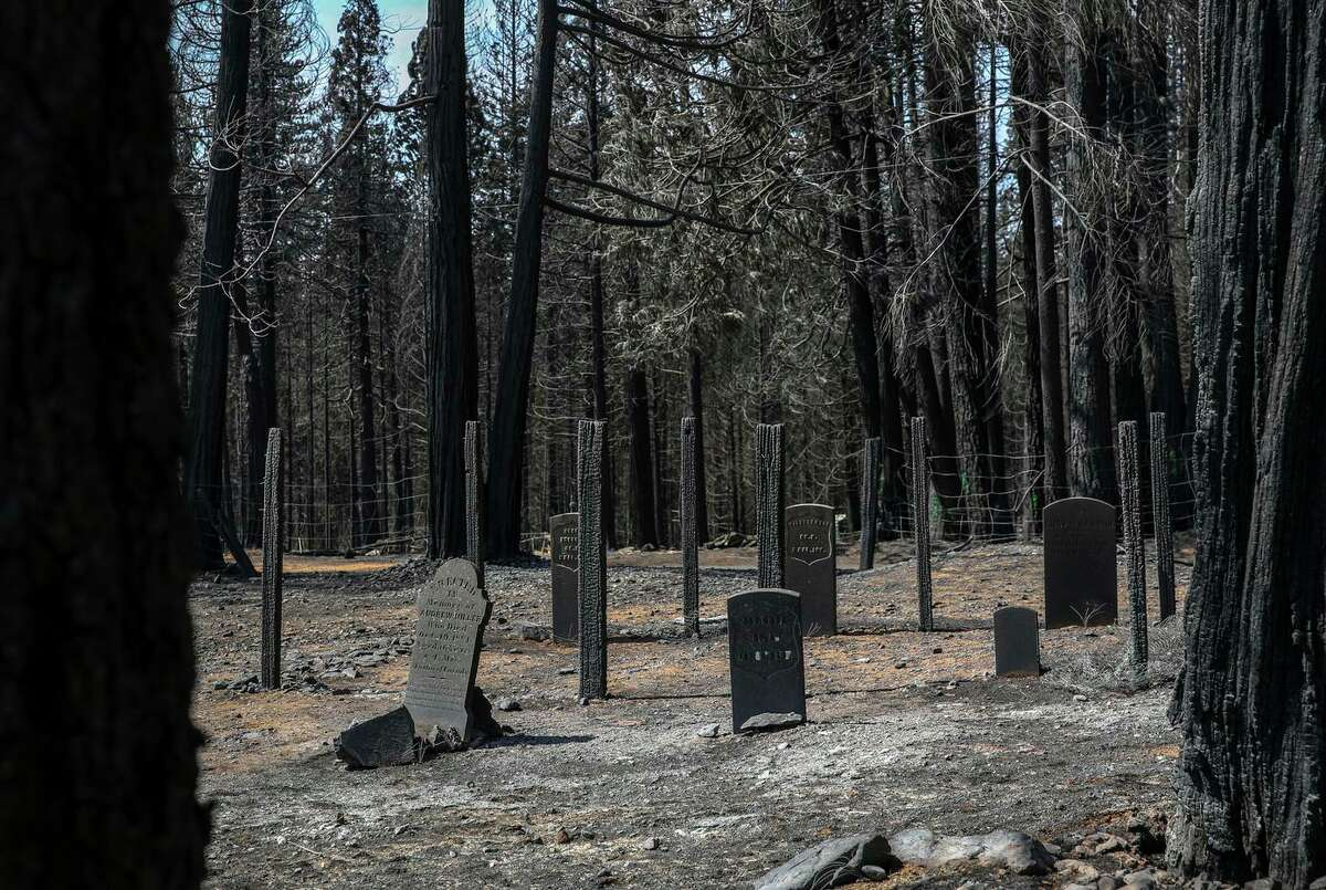 Headstones charred by the Caldor Fire, some dating as far back as the early 1800s, stand in the Pioneer Cemetery in the Gold Rush town of Grizzly Flats (El Dorado County).
