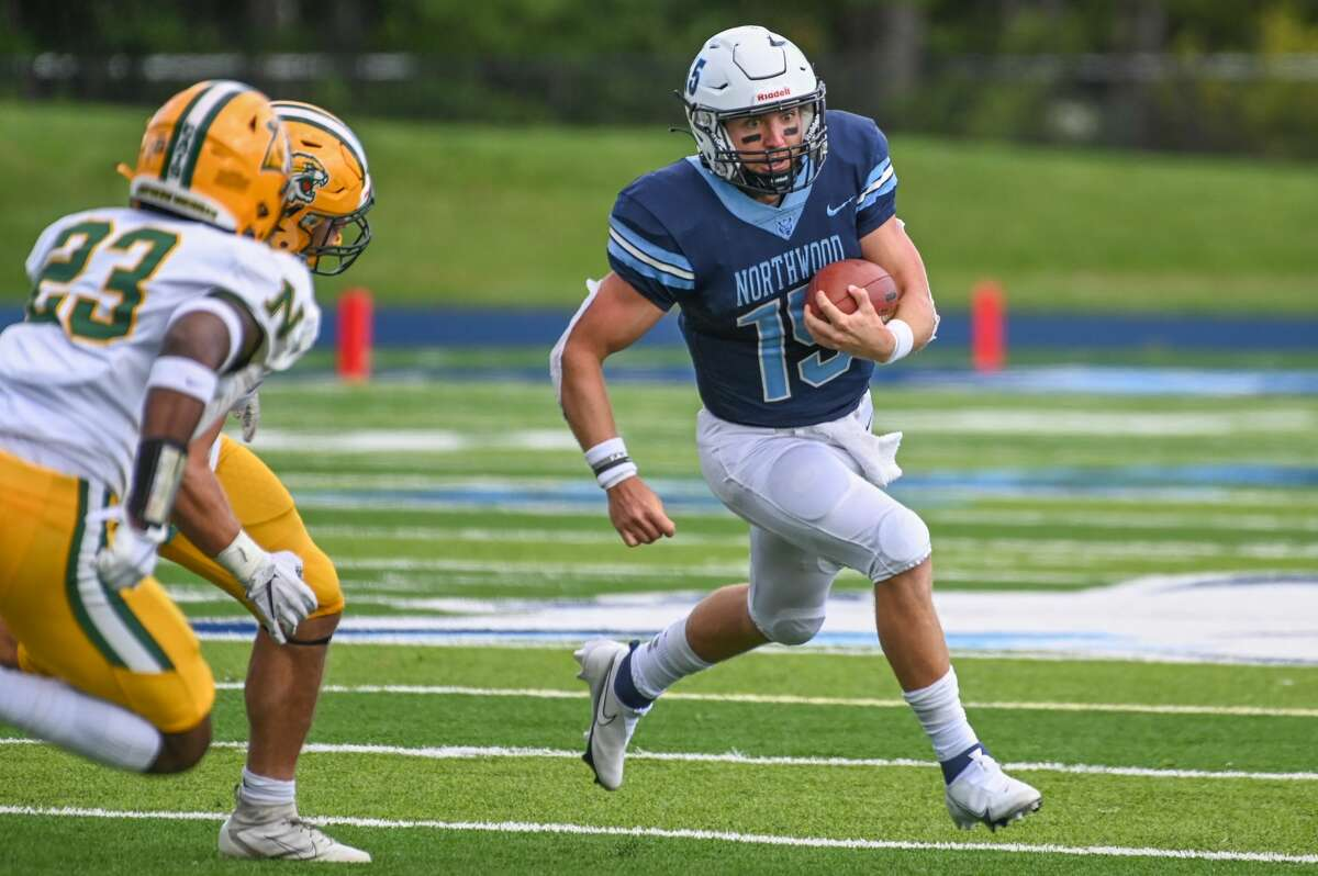Northwood's Ty Cox carries the ball during Saturday's 37-20 win over Northern Michigan, Sept. 25, 2021.
