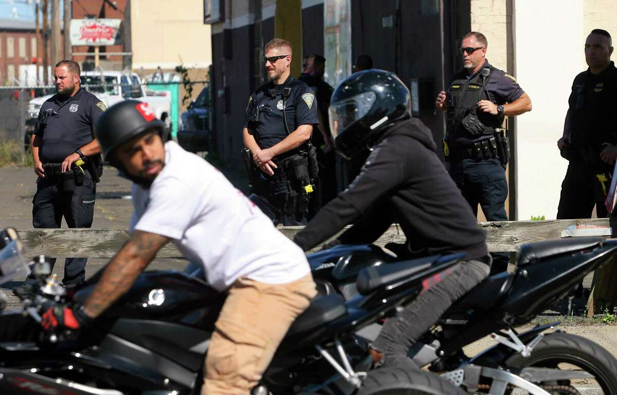 New Haven police keep watch as bikers descend on the city as part of EastCoastin' 2021 in New Haven, Conn., on Saturday September 25, 2021. Thousands of motorcyclists are expected to attend, even after the city refused to give a permit to the organizers.