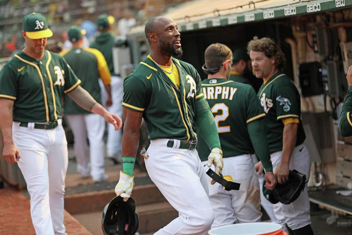 Oakland Athletics Starling Marte (2) in the dugout after his walk off hit in the ninth inning during an MLB game against the Houston Astros at RingCentral Coliseum on Saturday, Sept. 25, 2021, in Oakland, Calif.
