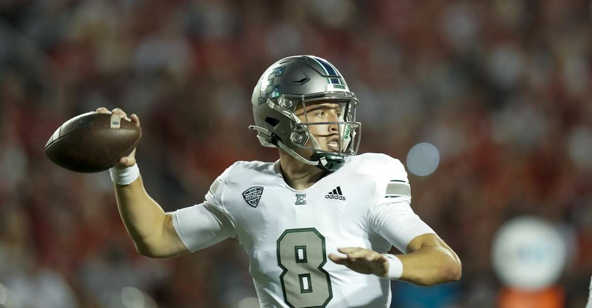 Eastern Michigan quarterback Ben Bryant (8) against Wisconsin during the first half of an NCAA college football game Saturday, Sept. 11, 2021, in Madison, Wis. (AP Photo/Andy Manis)
