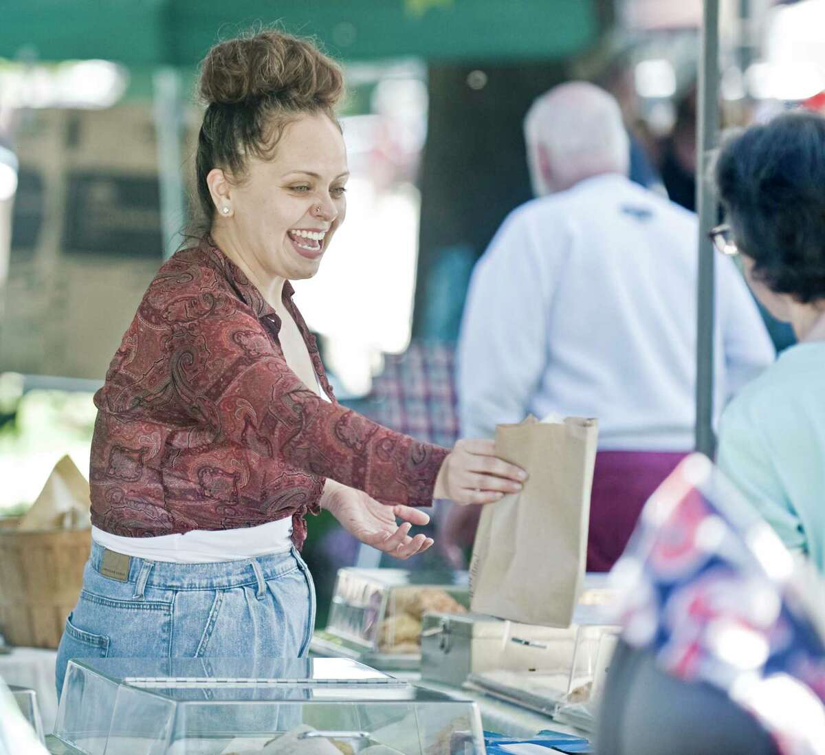 Amanda Hernandex, of the Green Granary in New Milford, selling scones at the Apple Festival on the New Milford town green. Saturday, Sept. 25, 2021
