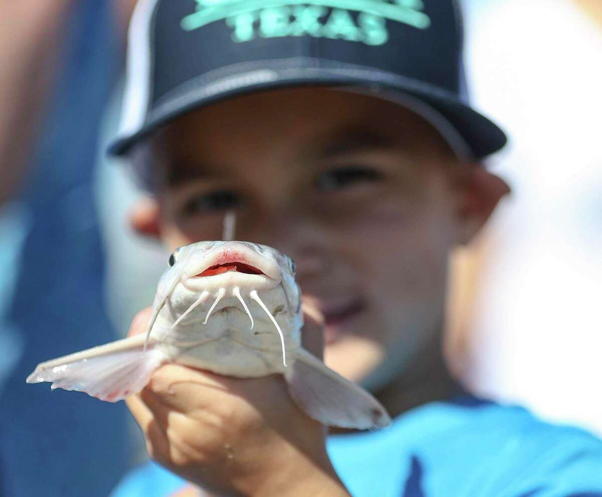 Beau Soto, 4, of San Marcos, holds up his fish as he waited in line to get it weighed during the 3rd annual Cast Away Rods Guppy Cup KidFish, Saturday, September 25, 2021, in Galveston.