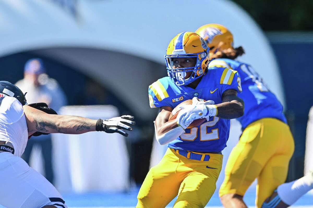 New Haven's Shamar Logan carries against Southern Connecticut on Saturday, Sept. 25, 2021. NCAA DII Football 2021 - SCSU at New Haven, DellaCamera Stadium, West Haven, CT