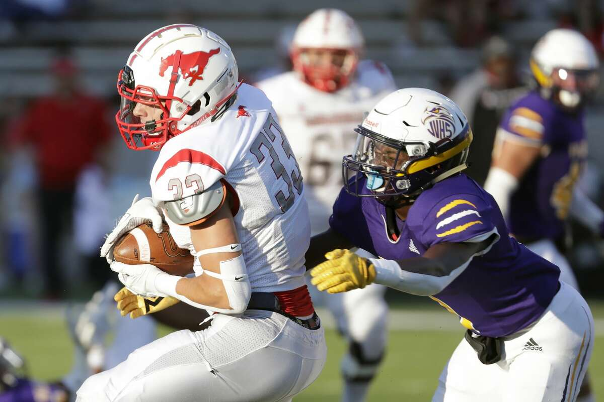 Memorial receiver Luke Sicola (33) pulls in a reception in front of Jersey Village defensive back Chris Noble during the first half of a high school football game at Pridgeon Stadium Saturday, Sept. 25, 2021 in Houston, TX.