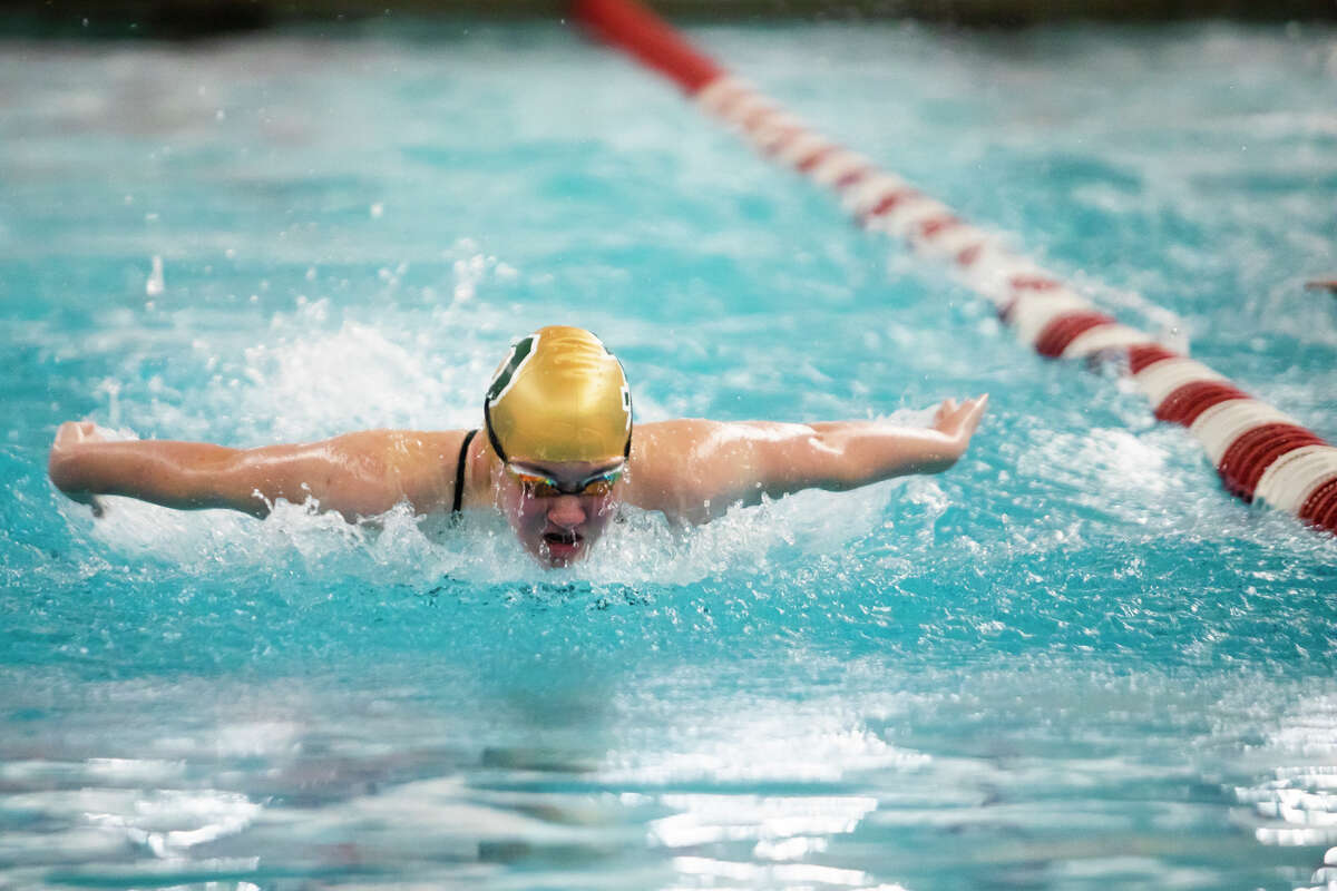 Dow High's Emmy Sower competes in the 100-yard butterfly during Thursday's Tri-Cities Championship prelims at Saginaw Valley State University, Sept. 23, 2021.