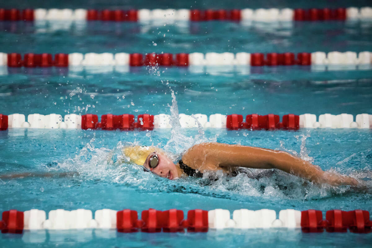 Dow High's Ella Roberson competes in the 200-yard freestyle during Thursday's Tri-Cities Championship prelims at Saginaw Valley State University, Sept. 23, 2021.