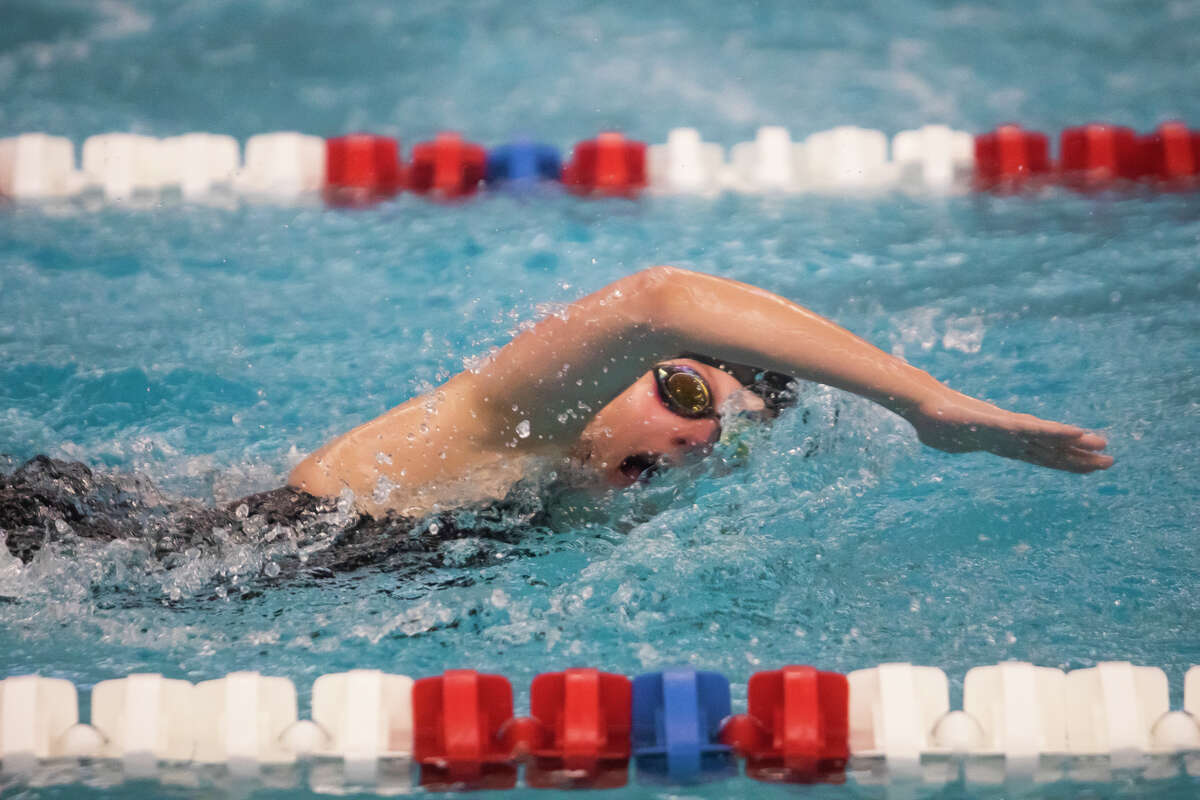 Midland High's Alyssa Rentsch competes in the 200-yard freestyle during Thursday's Tri-Cities Championship prelims at Saginaw Valley State University, Sept. 23, 2021.