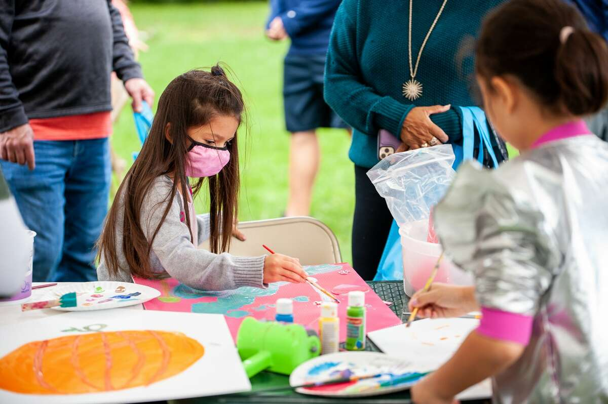 Saginaw resident Aurelia Reyes, 6, paints at the Big Read program kickoff on Sept. 25, 2021 at Creative 360. Big Read is a year-long program that is like a community book club.