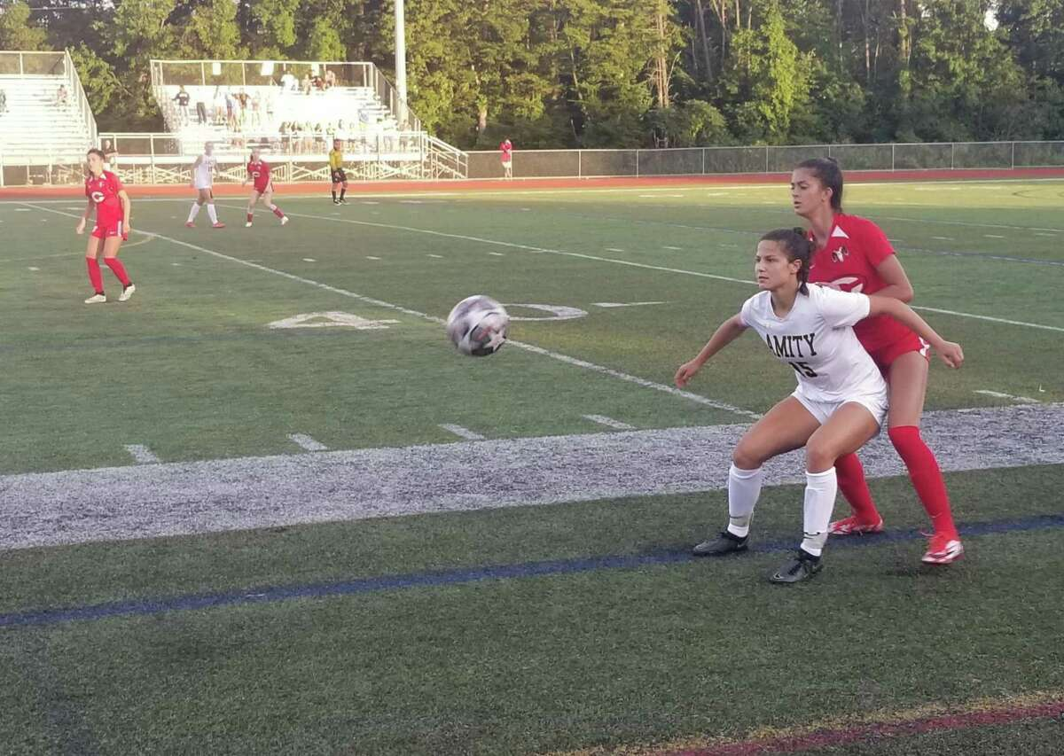 Amity's Audrey Marin shields Cheshire's Crerar from the ball during the second half of Amity's 2-1 win on Sept. 25, 2021.