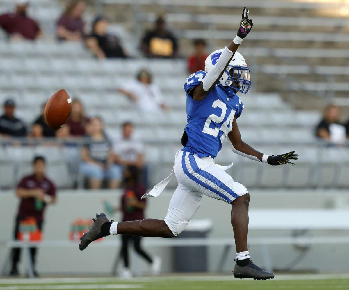 Cypress Creek defensive back Carson Williams (24) reacts after intercepting Northbrook quarterback Brandon Dillard for the second time during the first quarter of a high school football game, Saturday, Sept. 25, 2021, in Cypress.